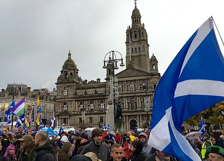 Protest with people holding Scottish flags