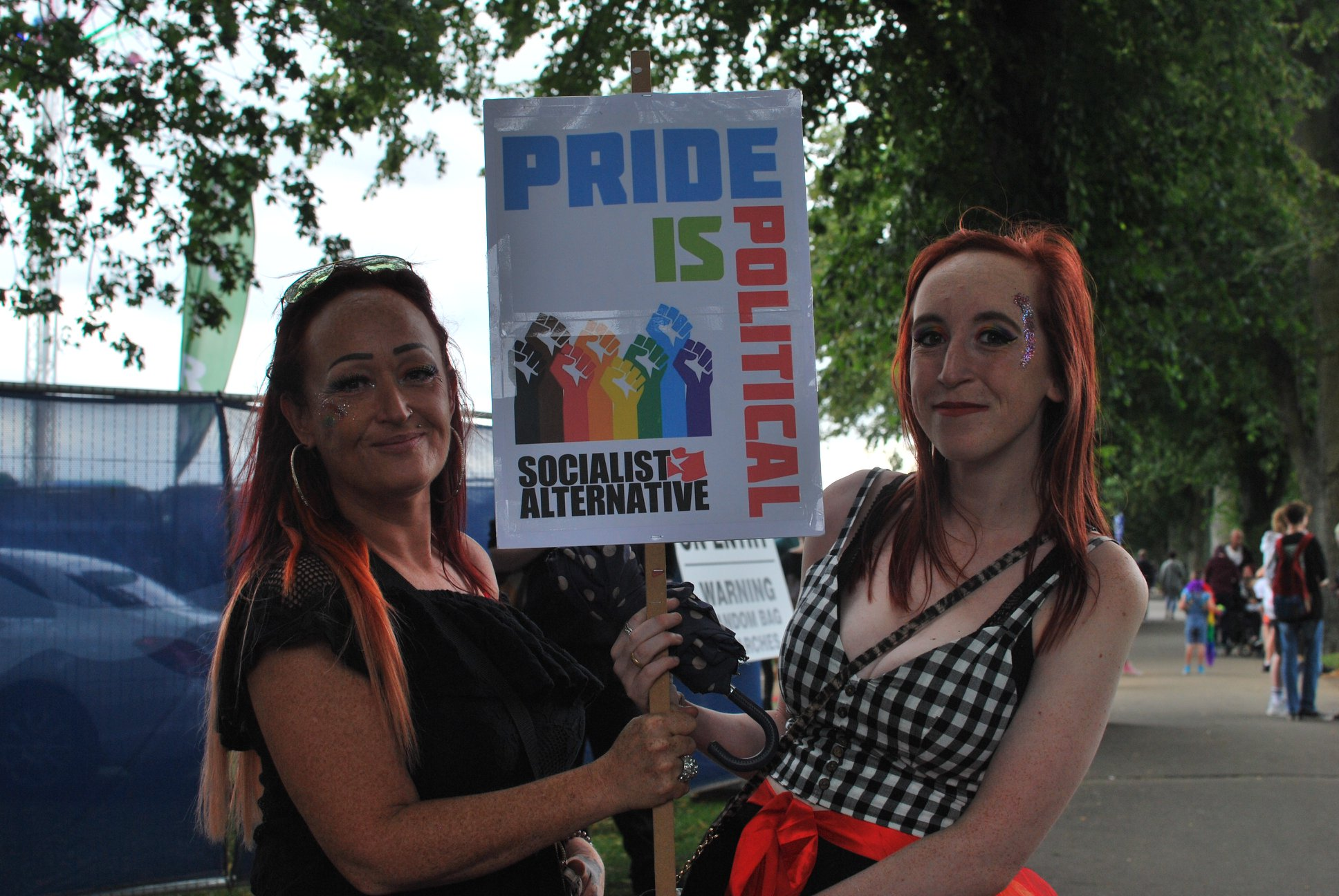 Two women with placard saying 'pride is political'