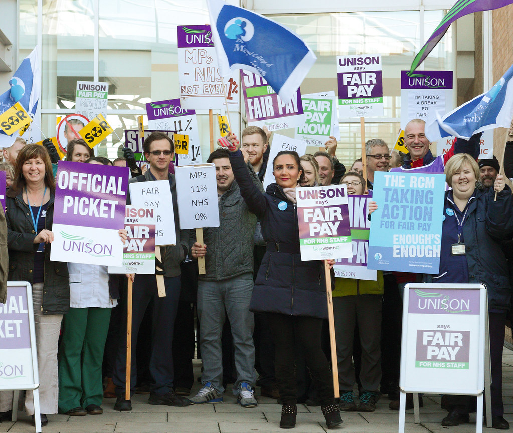 """""""Pickets at Norfolk and Norwich University Hospital during the second 4 hour pay strike"""" by Roger Blackwell is licensed under CC BY 2.0"""